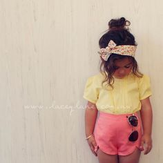 Vintage style blouse. Sunshine yellow wooden button up back. Love!! Lacey Lane children's fashion for little girls. Paired with coral Maison petal shorts. High waisted. Aviators and headscarf styling