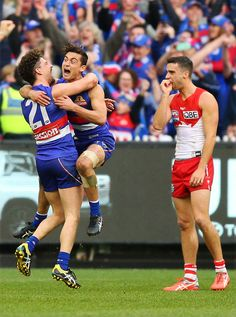 Luke Dahlhaus of the Bulldogs and Tom Liberatore celebrate the win after the final siren during the 2016 AFL Grand Final match between the Sydney. Western Bulldogs, Australian Football, Rugby Men, Great Team, Athletic Men, Pro Cycling, World Of Sports, Sport Man