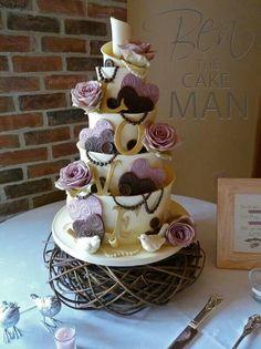 Beautiful l8ve cake cream and purple
