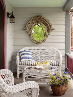 The wicker patio set was a hand-me-down from a friend. Another pal sewed the love seat's cushion and pillow from fabric Cathy scored at Jo-Ann. #countryliving #patios