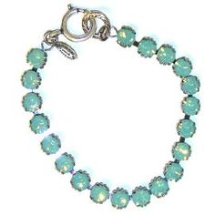 Catherine Popesco Sterling Silver Plated Tennis Bracelet with Pacific Opal Swarovski Crystals