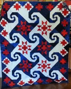 "Shakespeare in the Park in red, white and blue by Sue Carter, from a class at Honey Bee Quilt Store.  Design in ""The Creative Pattern Book"" 2000 by Judy Martin Quilts"