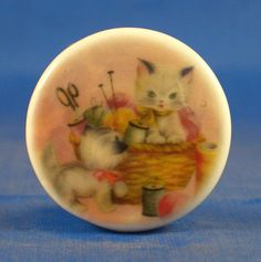 "1""  PORCELAIN CHINA  BUTTON -- KITTEN IN SEWING BASKET"