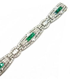 Emerald and diamond bracelet by Cartier. S.J. Philips.