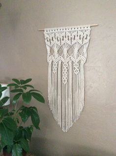 Soft and Elegant  I created this beautiful Macrame Wall Hanging with hanging crystals to be hung outside as Garden Art or in your window or beautifully inside as a Wall Tapestry. No matter where you place it, your home will be made more beautiful with it.   Handmade and original design by Lucy Lanuza   1/4 soft cotton rope  Size is approximately: Wooden dowel length- 25 Macrame width- 21 Macrame length- 46   Made to order   Your satisfaction is our number one priority...
