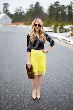 I have this skirt and usually wear it with a chambray shirt.