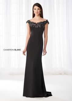Cameron Blake 218618 - Awe-inspiring and alluring, this stretch crepe slim A-line gown presents an off-the-shoulder neckline adorned with metallic lace and hand-beaded appliqués, slimming princess lines, and a sweep train. A matching shawl is included. Mob Dresses, Wedding Dresses, Vestidos Mob, Cameron Blake, Mother Of The Bride Dresses Long, Off Shoulder Gown, Long Formal Gowns, Womens Dress Suits, A Line Gown