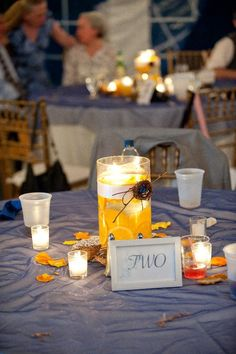 Pretty DIY centerpiece w/lemon slices & floating candles (I would skip the mini bird's nest)