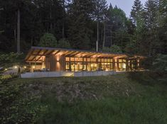 Modern home with Exterior, House, Wood Siding Material, and Metal Roof Material. The Cabin at night Photo 6 of Brightwood Cabin