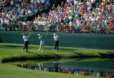 Sean O'Hair, Tiger Woods and Mark O'Meara skip their balls over the water during a practice round prior to the start of the 2012 Masters Tournament at Augusta National Golf Club on April 4, 2012 in Augusta, Georgia.