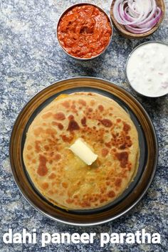 stuffed dahi paratha recipe | dahi paneer paratha | aloo dahi paratha with step by step photo and video recipe. paratha recipes are one of the staple food for many indians. it is generally served for morning breakfast, but can also be served for lunch and dinner. generally these are stuffed with boiled and spiced veggies, but can also be made with other ingredients like hung yoghurt, and making a creamy and filling flatbread.