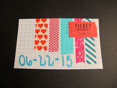 022/061. Decorative tape & a red ticket.