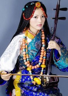 Tibet traditional costume and instrument