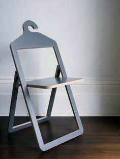 Hanger Chair by Philippe Malouin: Fold and use as a hanger. Unfold and have a seat.