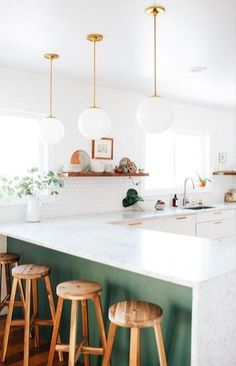 Paint green under the bar top. Pops of colour in a minimally white kitchen.
