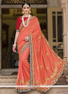 Grab the second look in this elegant attire for this season. Attract compliments by this peach silk designer saree. You can see some fascinating patterns done with embroidered, patch border and zari w...