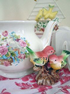 Colorful floral teapot with sweet pink birds.