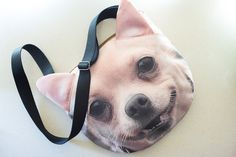 This is a 2-sided dog face print round bag, the strap is black woven fabric. You can see her ears are 3-dimensional, so cute! It is made in synthetic