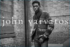 Sheani Gist dons a patterned cardigan sweater from John Varvatos.
