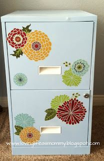 spray paint and decorate with decals (Target). Wonder if we can do this??? I'd love to pretty up that ugly file cabinet