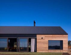 Wood siding with gable roof.. I love this use of wood siding in such a modern way.