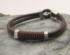 FREE SHIPPING Men's leather bracelet. Multi strand leather bracelet with silver plated spacers and clasp.