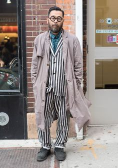 """Kenshin,45""""I'm wearing a coat and shirt by Robert Geller, a suit by N Hoolywood, shoes by Common Project. I just enjoy wearing clothes with good philosophy and design.""""Apr25,2017 ∙ SoHo"""