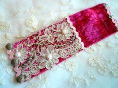 handmade bracelet with victorian lace hot pink velvet flapper rhinestones pink sequins, edwardian metallic buttons. $35.00, via Etsy.