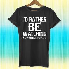 supernatural, Id rather be watching supernatural, supernatural shirt,... ($19) ❤ liked on Polyvore featuring tops, t-shirts, tees, shirt tops, graphic print t shirts, birthday shirts, collared shirt and birthday tee