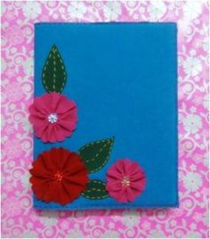 Project Idea -- Floral Felt Book Cover from Art Platter. Could use my favourite crafty flowers on one!