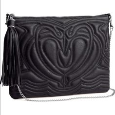 HPH&M Black Leather Tassel Clutch As seen in my Zara leather skirt listing, this H&M black leather clutch with a tassel zipper opening and a beautiful embossed pattern is a beauty. Used a handful of times but still in excellent condition. Host pick on 12/19! H&M Bags Clutches & Wristlets