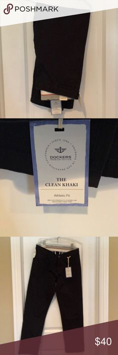 NWT Dockers Clean Khaki Athletic Fit Navy 33/30 NWT Dockers Clean Khaki Athletic Fit Navy, size 33/30.  Flat front with 2 front pockets.  Button and zip front.  2 back pockets with button closure.  These retail for $78. Dockers Pants Chinos & Khakis