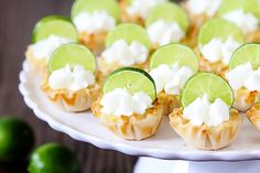 These adorable key lime tartlets from Gimme Some Oven are a crowd-pleasing dessert. Mini tart shells are made from phyllo dough, a Greek pastry made from thin sheets of dough. The filling is made from a combination of sweetened condensed milk, Mini Desserts, Dessert Recipes, Tropical Desserts, Lemon Desserts, Party Desserts, Healthy Desserts, Lime Recipes, Easy Recipes, Fudge Recipes