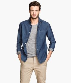 Slim-fit long-sleeved shirt in washed denim, with button-down collar chest pocket. | H&M Denim