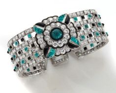 Art Deco Mauboussin platinum, diamond, emerald and black onyx bracelet, Estimate: