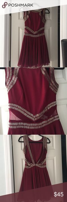 Burgundy dress with beads Short burgundy dress with cut outs and beading, has a deep open back, skater style skirt. Only worn once, perfect condition! ASOS Dresses Mini