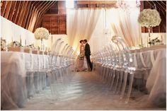 Modern chairs-sophisticated decor wrapped up in a country atmosphere---the perfect country chic wedding!