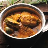 Fish Gassi: Delicious fish stir fried in a coconut and masala paste, simmered in tamarind paste and coconut milk.