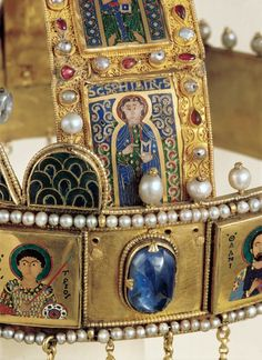 Huge Sapphire Between Saint Demetrios and Saint Damianos Most of the big stones of the diadem are semi-faceted. The hanging cabochon drops are customary on Byzantine diadems. They add flash and color to a man's long hair as he moves.