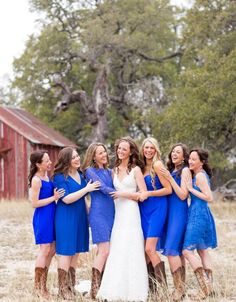Bridesmaids all dressed in blue with cowboy boots- I really like this blue, probably too bright for Kevin though