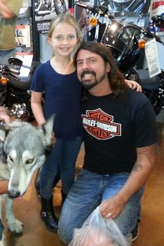 Dave Grohl with his daughter Violet at a celebration today in Glendale, CA. Harley Davidson.