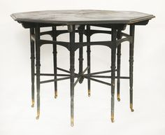 An ebonised coromandel and inlaid octagonal centre table, designed by E W Godwin (1833-1886), probably manufactured by Collinson & Lock, raised on turned tapering legs, supporting horizontal bars centred with a spindle, fitted with brass caps and castors, Sold for £31,000 on 2nd June 2015 The table is believed to have been purchased by Andrew Muir (1817-1899), a wealthy merchant who, with Archibald Mirrielees (1797-1877), established Muir & Mirrielees in Moscow. The department store became a…