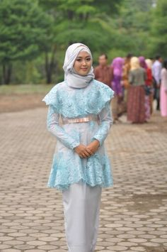 Sky blue lace kebaya-inspired dress. Cape for covering the bosom, empire cut with peach satin ribbon and skinny inner dress to balance the whole look (with pleated cut line in the back for a little room to walk).