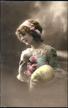 Antique French Easter Postcard - Hand-tinted with lovely pastel colors, from the light blush on her cheek and roses to the lovely pale yellow on the large Easter egg that she cradles in her arm.
