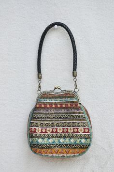 bag with a kiss lock by Neonila1 on Etsy