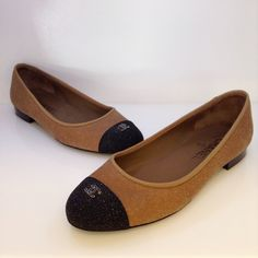 Chanel two tone ballet flats with slight sparkle and signature CC at toe. Size 38. Please call (949)715-0004 for inquiries.