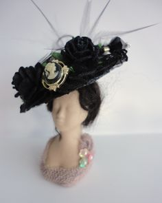1:12th scale (dolls house) Edwardian Mourning/Gothic hat by Kat Hazelton (Kat the hat lady) This hat is for sale(at time of posting) at 'Bear Cabin Miniatures Artisan Dolls House Shop' in Swansea indoor Market, Wales.https://www.facebook.com/pages/Bear-Cabin-Miniatures-Artisan-Dolls-House-Shop/110950918969758