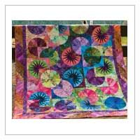 """$234.99.  STUNNING! Overlapping patterns and vibrant hues meet in this 67"""" x 80"""" foundation-pieced quilt made using 2 1/2"""" strips.  Kit includes fabrics for the top and binding, including precut Hoffman Bali Pops strips, and pattern with Judy and Bradley Niemeyer's directions and printed paper foundations."""