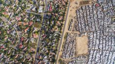 A PHOTOGRAPHER has captured the stark contrast between how the rich and poor live in South Africa — side by side, but clearly separate.