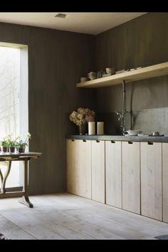 wood kitchen; concrete countertop; wide wooden floor; dark grey walls